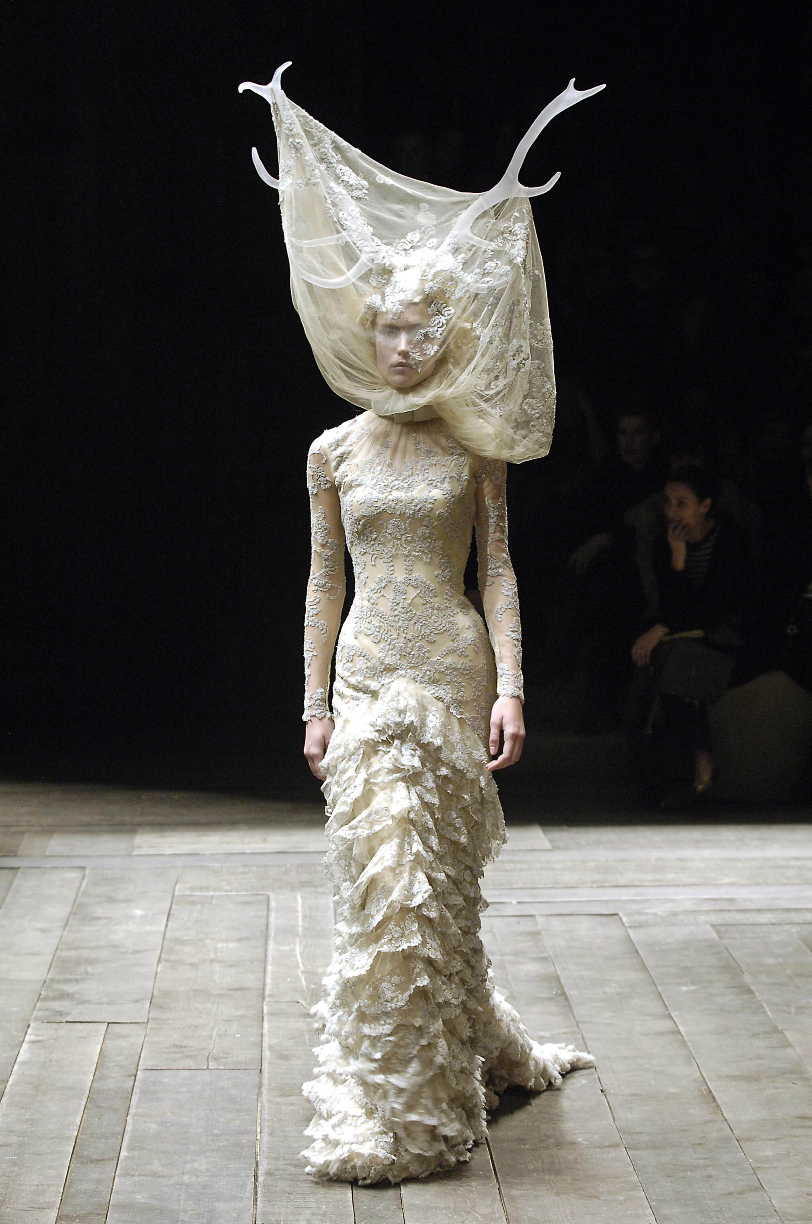 5._Tulle_and_lace_dress_with_veil_and_antlers_Widows_of_Culloden_AW_2006-07._Model_Raquel_Zimmermann_Viva_London._Image_firstVIEW